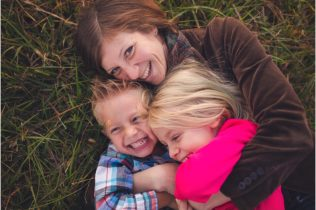 Mom tickling kids and having fun during family photography session near Baltimore DC Maryland