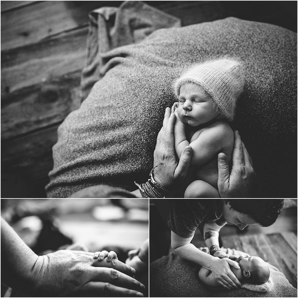 how to soothe newborn baby in photography session with big hands