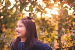 little girl smiling at gaver farm maryland family outdoor photography real life fun photos