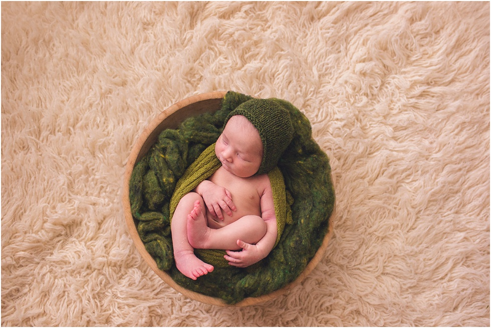 baby boy wrapped in bowl green hat and stuffer